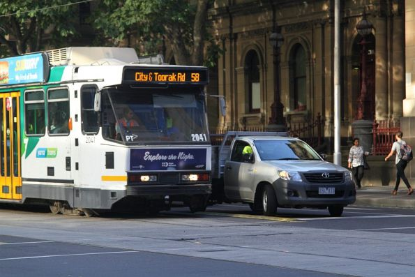Driver of tram B2.2041 dings at a right turning car blocking the tram lane at William and Little Bourke Street