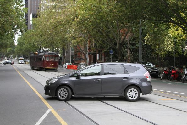 Motorist pulls a u-turn over the tram tracks on Bourke Street