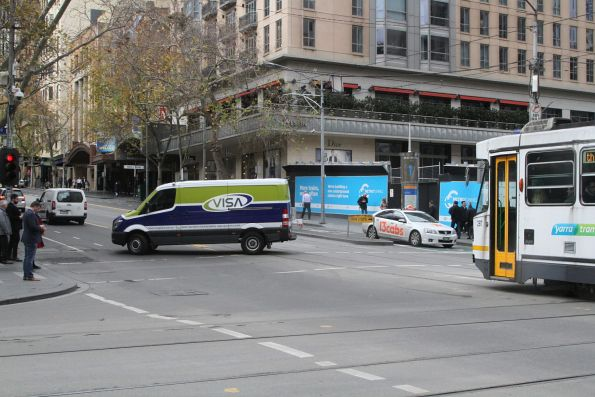 Van driver pulls a u-turn in front of A2.287 at Collins and Swanston Street