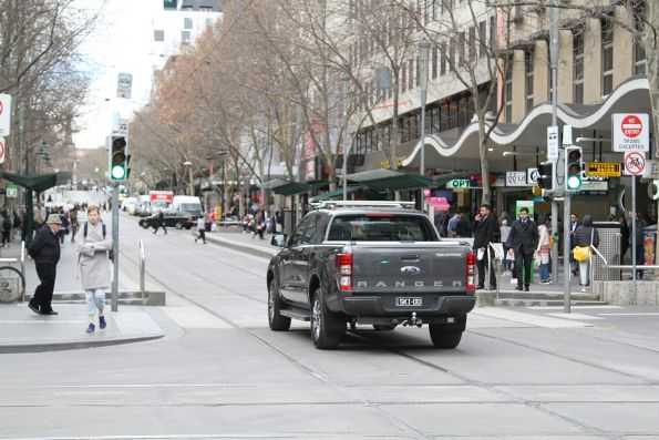 Confused motorist wonders what to do that corner of Swanston and Bourke Street - so drives east through the tram stop