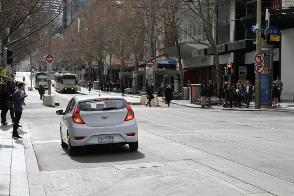 Confused motorist decides what to do at the corner of Swanston and Bourke Street