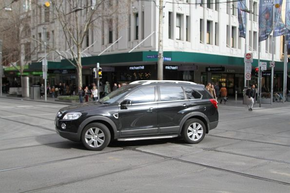 Confused motorist after correctly choosing to u-turn at the corner of Swanston and Bourke Street