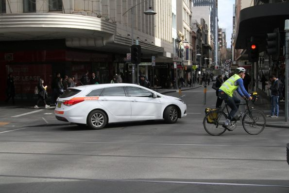 Confused motorist tries to turn off Swanston Street into a closed Little Collins Street