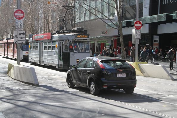 Confused motorist drives north through the tram stop at Swanston and Bourke Street