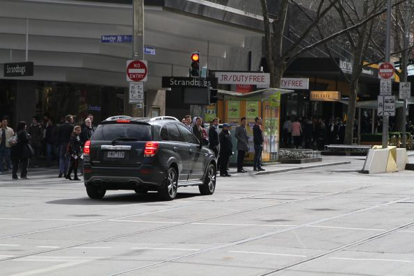 Confused motorist reverses back out of the Swanston and Bourke Street tram stop