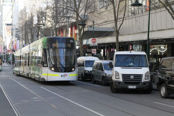 E.6036 on route 96 waits for a van parking on Bourke Street