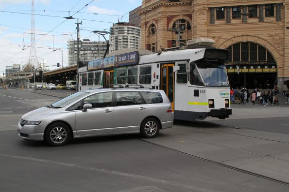 Z3.153 waits for a car blocking the corner of Swanston and Flinders Street