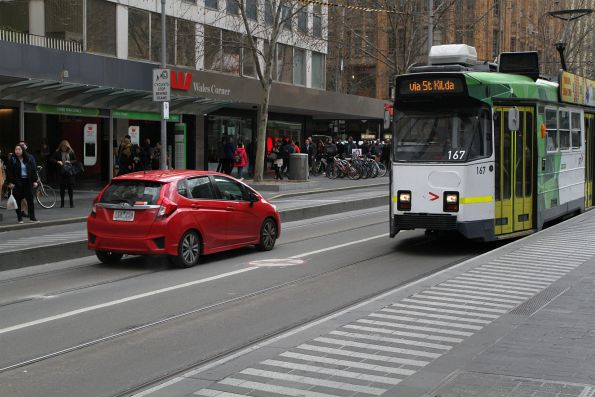 Z3.167 passes a confused motorist driving through the tram stop at Swanston and Collins Street
