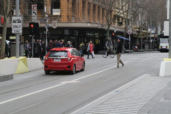 Confused motorist drives through the tram stop at Swanston and Collins Street