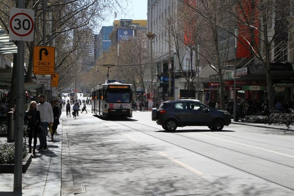 This driver does the right thing, and does a u-turn at the intersection of Swanston and Bourke Street