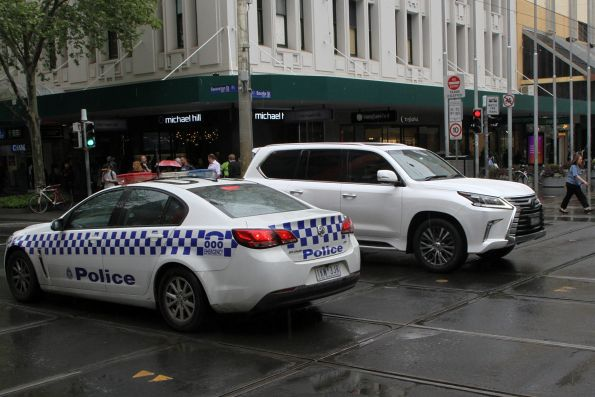 Victoria Police notice a confused motorist at the corner of Swanston and Bourke Street