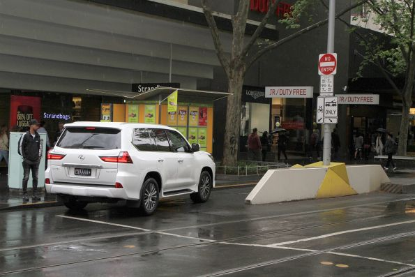 Confused motorist starts to drive down the bike lane at the corner of Swanston and Bourke Street
