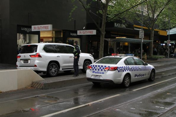 Victoria Police chase down a confused motorist at the corner of Swanston and Bourke Street