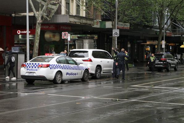 Victoria Police give a ticket to the confused motorist the corner of Swanston and Bourke Street
