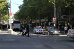 Victoria Police ready to book a confused motorist who drove through the tram stop at Swanston and Collins Street