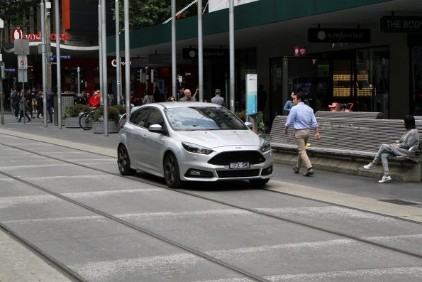 Dimwitted motorist drives through the Bourke Street Mall
