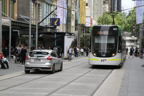 E.6007 passes a dimwitted motorist driving through the Bourke Street Mall