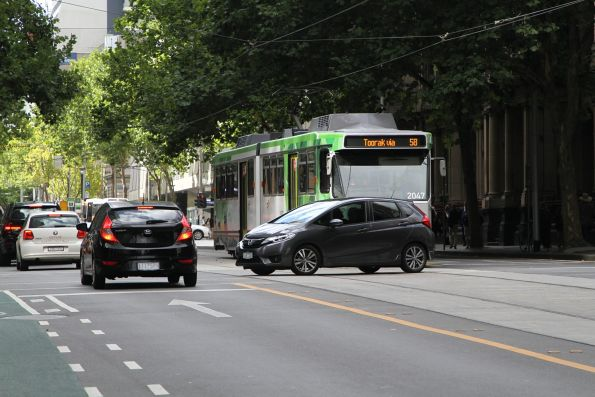 B2.2047 on route 58 delayed by a right turning car at William and Little Bourke Street