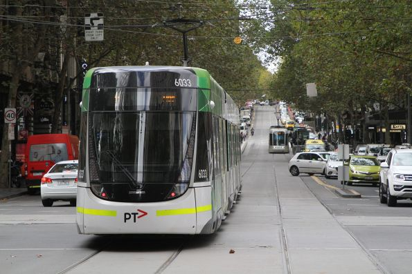 Driver pulls a u-turn over the Collins Street tram tracks, with nowhere to go