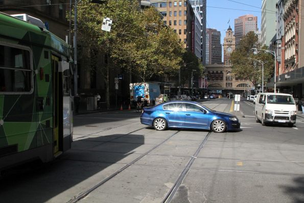 Car blocks the intersection of Collins and Elizabeth Street, delaying a southbound tram