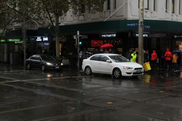 Two confused motorists at the corner of Swanston and Bourke Street