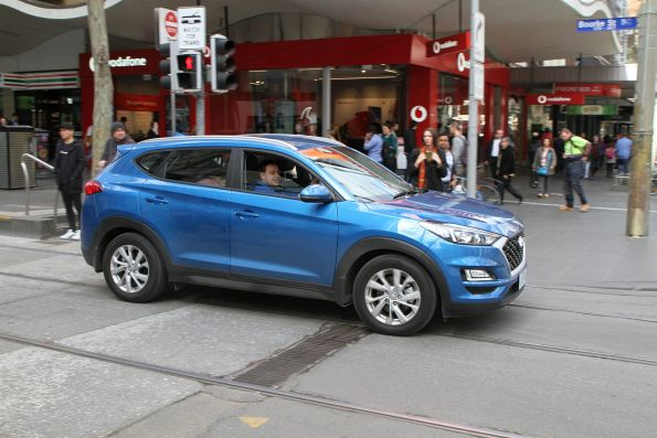 Confused motorist drives through the tram stop at Bourke and Swanston Street