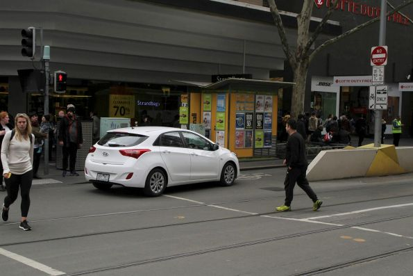 Senile old man drives through the tram stop at Swanston and Bourke Street