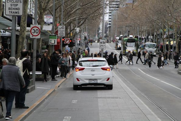 Second pedestrian has a go at a senile old man driving through the tram stop at Swanston and Bourke Street
