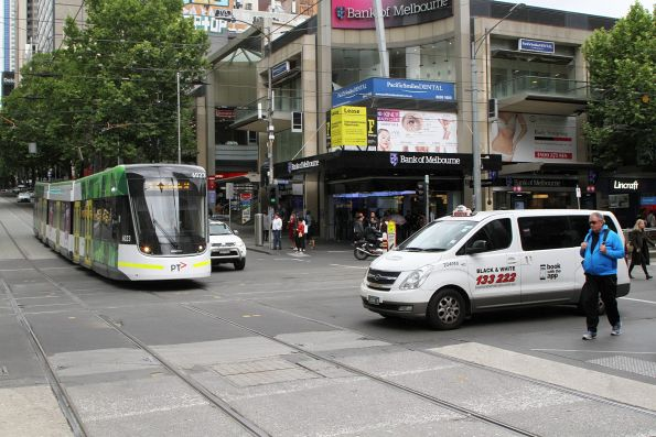 E.6023 on route 96 waits for a broken down taxi blocking the tracks at Bourke and Elizabeth Street