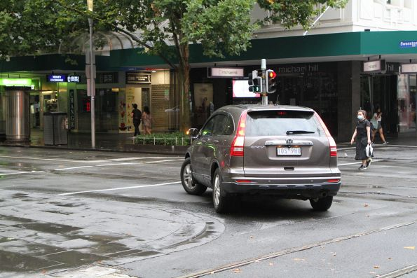 Dimwit driver followed a police car through the tram stop at Bourke and Swanston Street