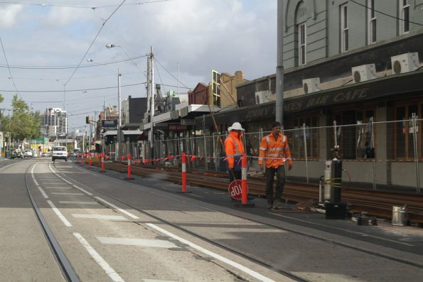 Work crews weld the rail into long length in preparation for the Mount Alexander Road works