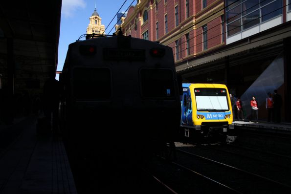 A Hitachi blocks the view of new liveried 863M at Flinders Street