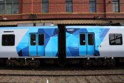 On each T car the blue forms an arrow pointing towards the front