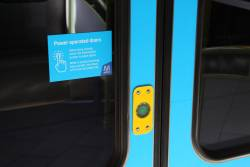 Power operated door sticker