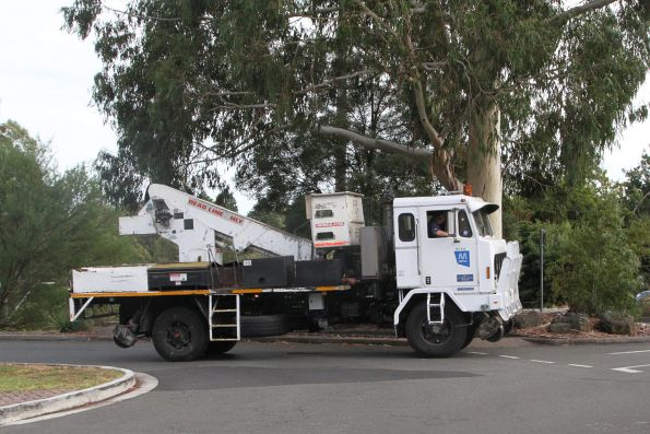 Metro Trains hi-rail bucket truck arrives at Belgrave to assist in reopening the line