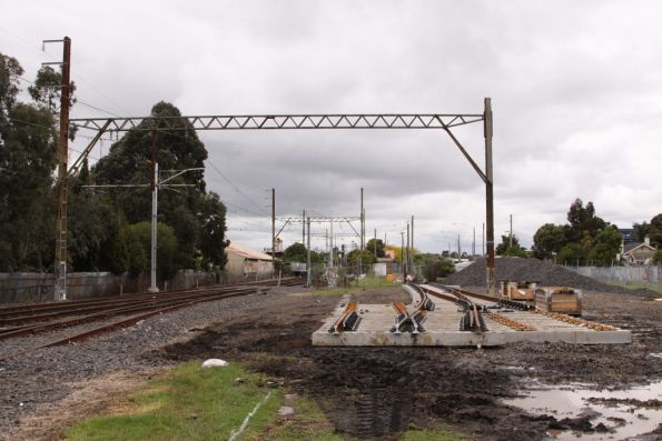 New crossover on concrete bearers bring assembled in the former goods yard at Bell