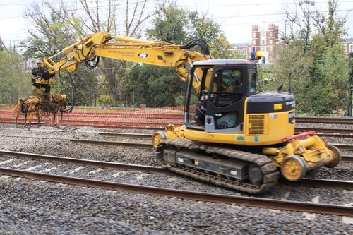 Hi rail excavator with tamper attachment about to get to work
