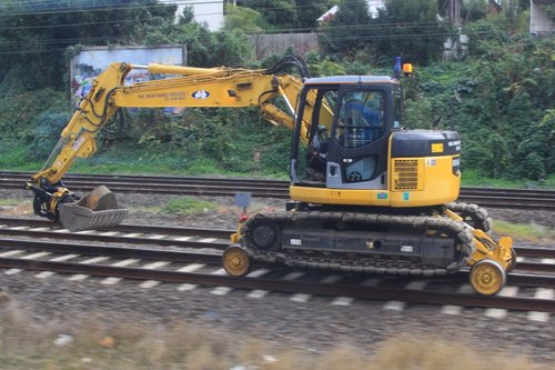 Hi rail excavator speeding along the tracks between work sites