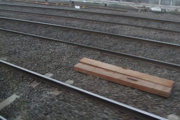 Timber sleepers ready to be inserted into the tracks at the down end of North Melbourne station
