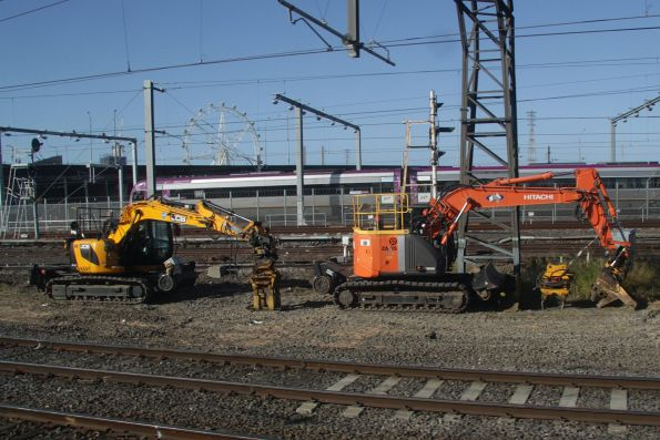 Hi-rail equipment ready to insert new timber sleepers at the down end of North Melbourne station