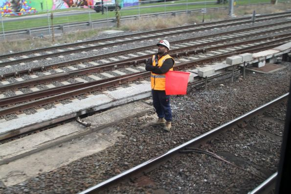 Flagman protecting workers on the suburban tracks at Southern Cross