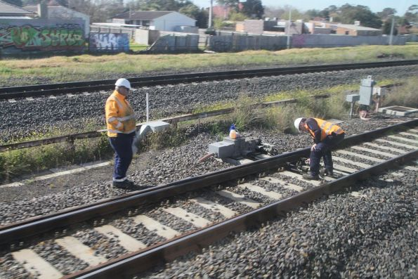 Maintenance staff inspect a set of points on the goods lines at Sunshine