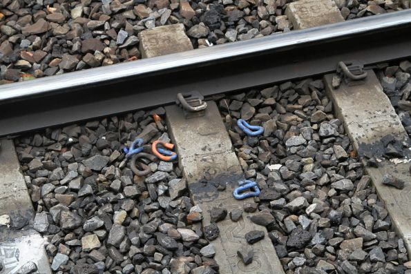 Various coloured pandrol clips discarded after replacing the rail at Flinders Street Station