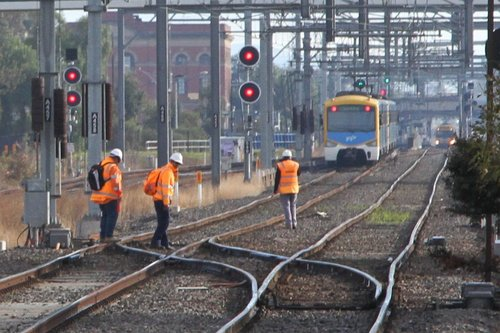 Maintenance staff get back to work after a down train departs Sunshine