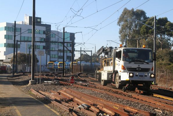 Hi-rail work platforms working on the overhead wires on the Glen Waverley line at Burnley