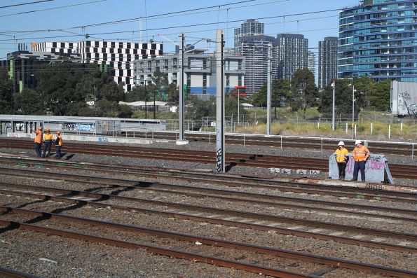 Metro staff inspect the tracks at Franklin Street