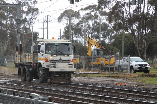 Hi rail dump truck at work clearing a mud hole on the Sunbury line at Albion