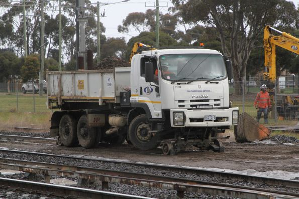 Hi rail dump truck exiting the work site on the Sunbury line at Albion