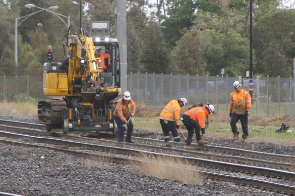 Hi rail excavator at work clearing a mud hole on the Sunbury line at Albion