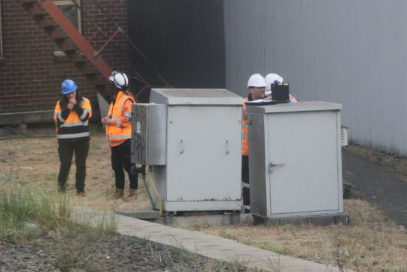 Metro Trains staff inspect a signalling cabinet at North Melbourne
